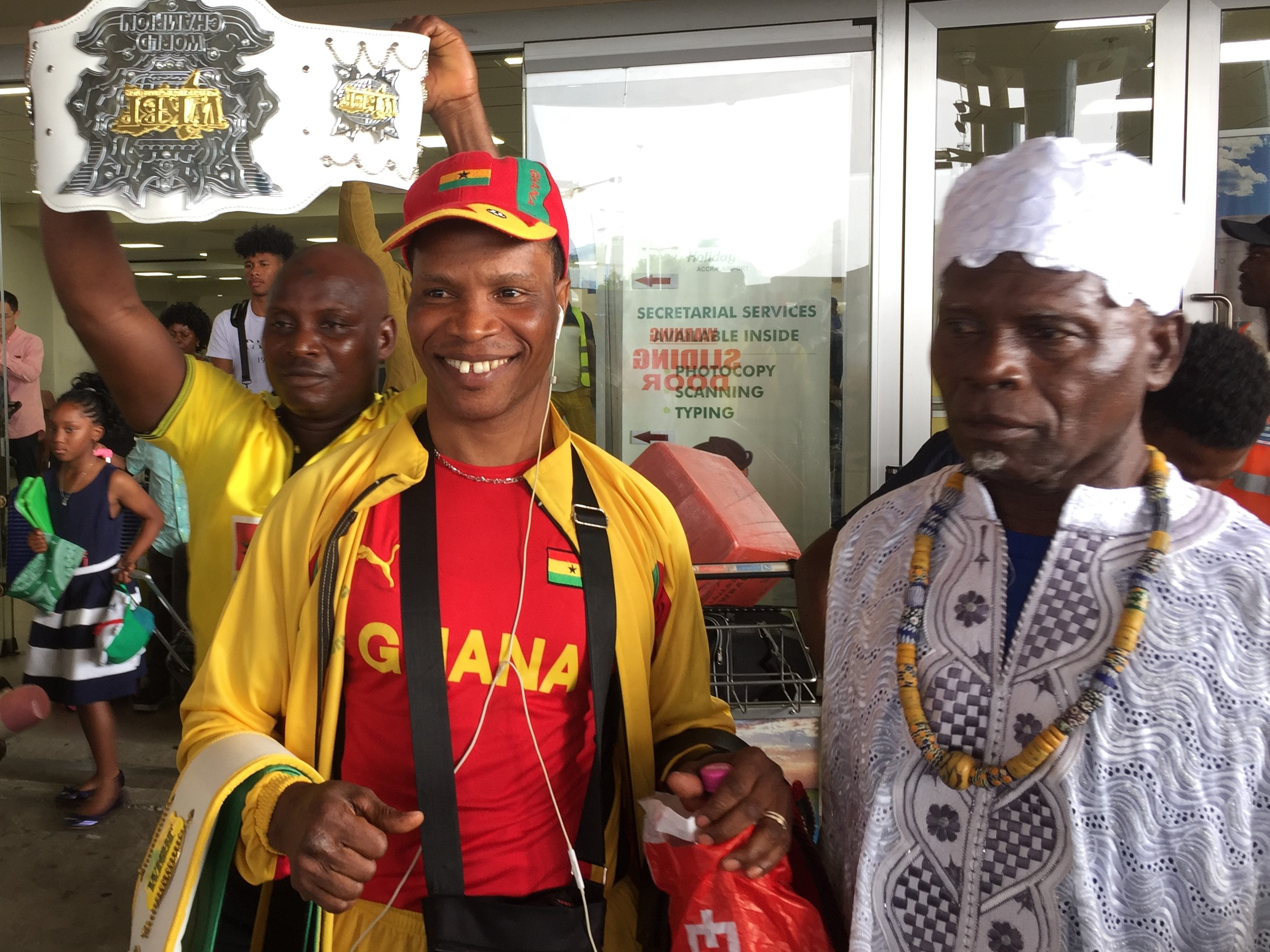 World Kick Boxing Champion Alhassan Okoe Okine mobbed by sports fans at Accra airport